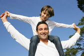 Little boy on his father's shoulders — Stock Photo