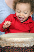 Little boy playing with djembe — Stock Photo