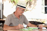Older man at an alfresco cafe — Stock Photo