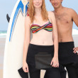 Stock Photo: Boy and girl with surfboard