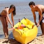 Boy and girl on the beach — Stock Photo