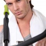 Sporty man in gym club — Stock Photo
