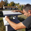 Stock Photo: Builder finishing gatepost