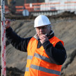 Stockfoto: Civil engineer with elevation reader