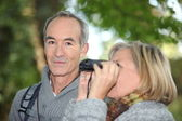 Husband and wife birdwatching in the forest — Stok fotoğraf