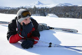 Male skier laying down in snow — Stock Photo