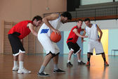 Basketball player dribbling — Stock Photo