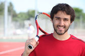 Tennis player stood with racket over shoulder — Stock Photo
