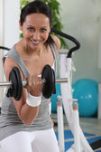 Woman using a dumbbell — Stock Photo