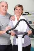 Mature couple resting after fitness — Stock Photo