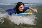 Woman on a surfboard — Stock Photo