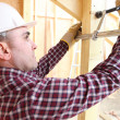 Builder using a clamp to fix two planks of wood together — Stock Photo #8820043