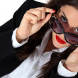 Businesswoman posing in sunglasses — Stock Photo #8836730