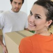 Couple carrying brown boxes — Stock Photo