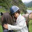 Little boy and his pony - Stock Photo