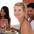 Friends eating dinner alfresco - Stock Photo