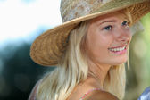 Summery woman in a straw hat — Stock Photo