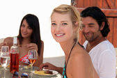Friends eating dinner alfresco — Stock Photo
