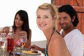 Friends eating dinner alfresco — Stock Photo
