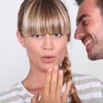 Couple sharing a secret — Stock Photo