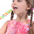 Royalty-Free Stock Photo: Little girl with multicolored lollipop