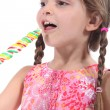 Little girl with multicolored lollipop - Photo