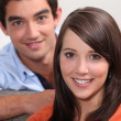 Head and shoulders of young couple — Stock Photo