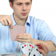 Young men playing cards — Stock Photo