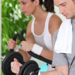 Two young doing fitness — Stock Photo