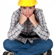 Stock Photo: Gloomy female construction worker