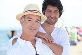 Father and son stood on pier — Stock Photo