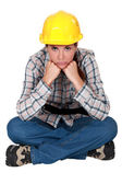 Gloomy female construction worker — Stock Photo
