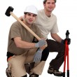 Workmen with sledgehammer and bolt cutters — Stock Photo #8910023