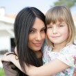Mother and daughter in the front yard — Stock Photo