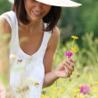 Stock Photo: Wompicking wild flowers