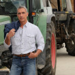 Farmer stood by tractor — Stock Photo #8911073