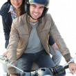 Stock Photo: Riding scooter together