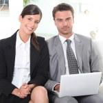 Business couple preparing presentation — Stock Photo
