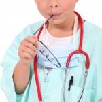 malá holčička, oblečený jako zdravotní sestra — Stock fotografie