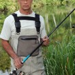 Man fishing in pond — Stock Photo #8913947