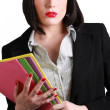 Attractive businesswoman carrying files — Stock Photo