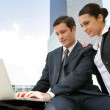 Businessman and businesswoman working outdoors — Stock Photo