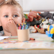 Little boy drawing with crayons — Stock Photo #8915181