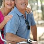 Mature couple riding bikes — Stock Photo #8915511