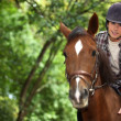 Young man riding horse — Stock Photo