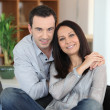 Portrait of young couple posing at home — Stok fotoğraf