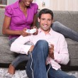 Couple playing video games at home — Stock Photo