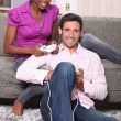 Couple playing video games at home — Stock Photo #8916872