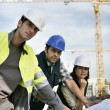 Workteam on construction site — Stock Photo