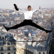 Businessman jumping for joy on a tightrope — Стоковая фотография